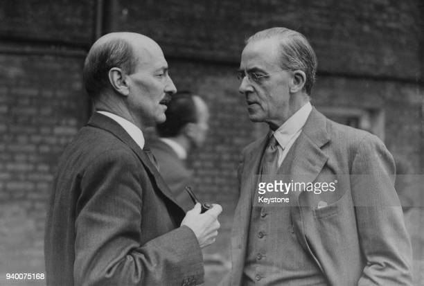 British Prime Minister Clement Attlee talking to Sir Stafford Cripps in the garden of 10 Downing Street London 23rd August 1945