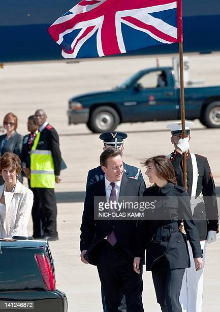 British Prime Minister David Cameron accompanies his wife Samantha to her side of the limousine at Andrews Air Force Base in Maryland on March 13,...