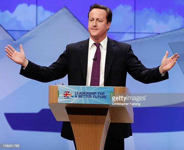 British Prime Minister David Cameron acknowledges the applause after delivering his keynote speech to delegates at the annual Conservative Party...