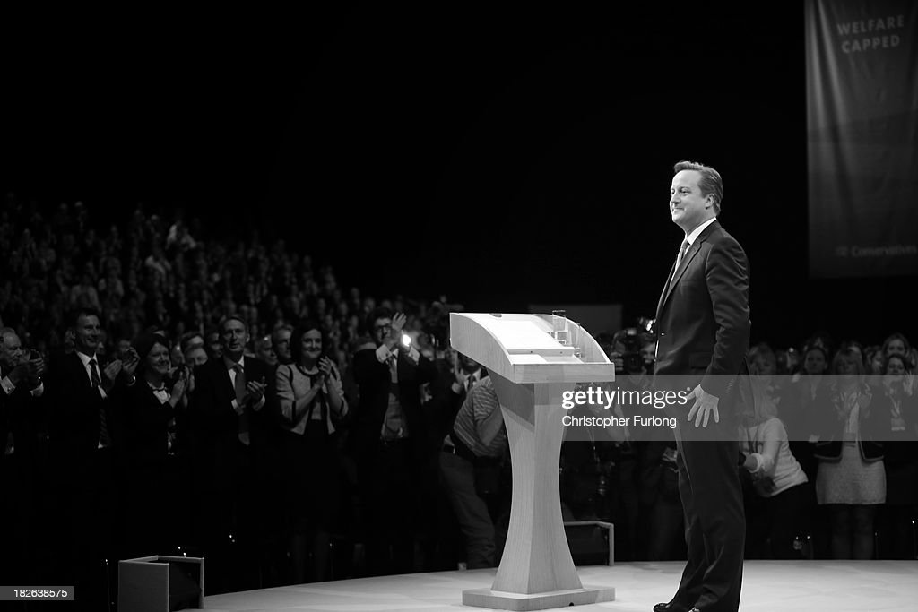 British Prime Minister David Cameron acknowledges the applause after delivering his keynote speech to delegates on the last day of the annual Conservative Party Conference at Manchester Central on October 2, 2013 in Manchester, England. During his closing speech David Cameron said that his 'abiding mission' would make the UK into a 'land of opportunity'.
