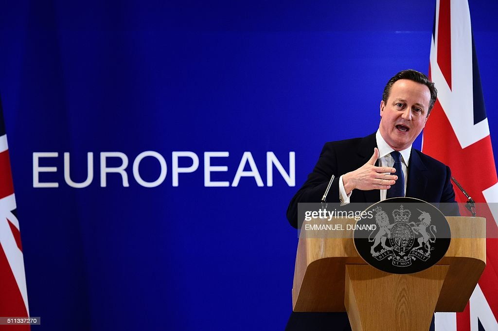 TOPSHOT - British Prime Minister David Cameron addresses a press conference at end of an European Union (EU) summit in Brussels on February 19, 2016. European leaders sealed a deal with the UK after hours of haggling at a marathon summit, paving the way for a referendum on whether Britain will stay in the EU. The European Union's two top figures, Donald Tusk and Jean-Claude Juncker, presented its 28 leaders with draft proposals at a long-delayed dinner after hours of painstaking face-to-face talks on an issue that threatened place in the union. / AFP / EMMANUEL