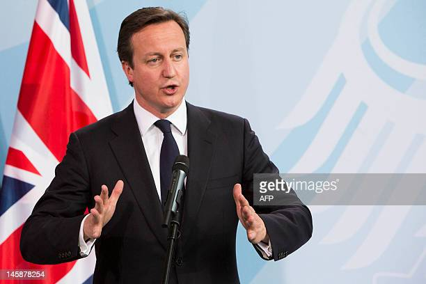British Prime Minister David Cameron addresses a press conference with German Chancellor Angela Merkel at the chancellery in Berlin on June 7, 2012....