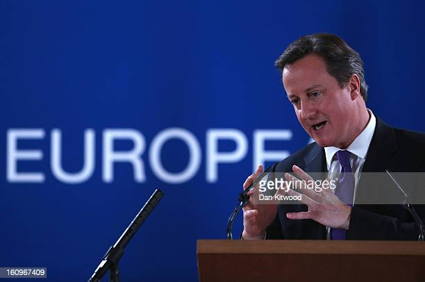 British Prime Minister David Cameron addresses the media at the headquarters of the Council after reaching a deal on the budget for 201420 on...