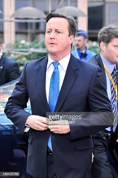 British Prime Minister David Cameron adjusts his jacket as he arrives prior to an European Council at the Justus Lipsius building, EU headquarters in...
