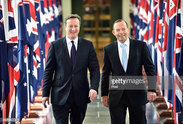 British Prime Minister David Cameron and Australian Prime Minister Tony Abbott leave the House of Representatives at Parliament House on November 14...