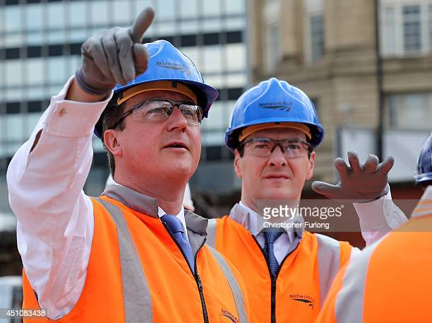 British Prime Minister David Cameron and British Chancellor George Osborne tour building works at Manchester's Victoria Railway Station which is...
