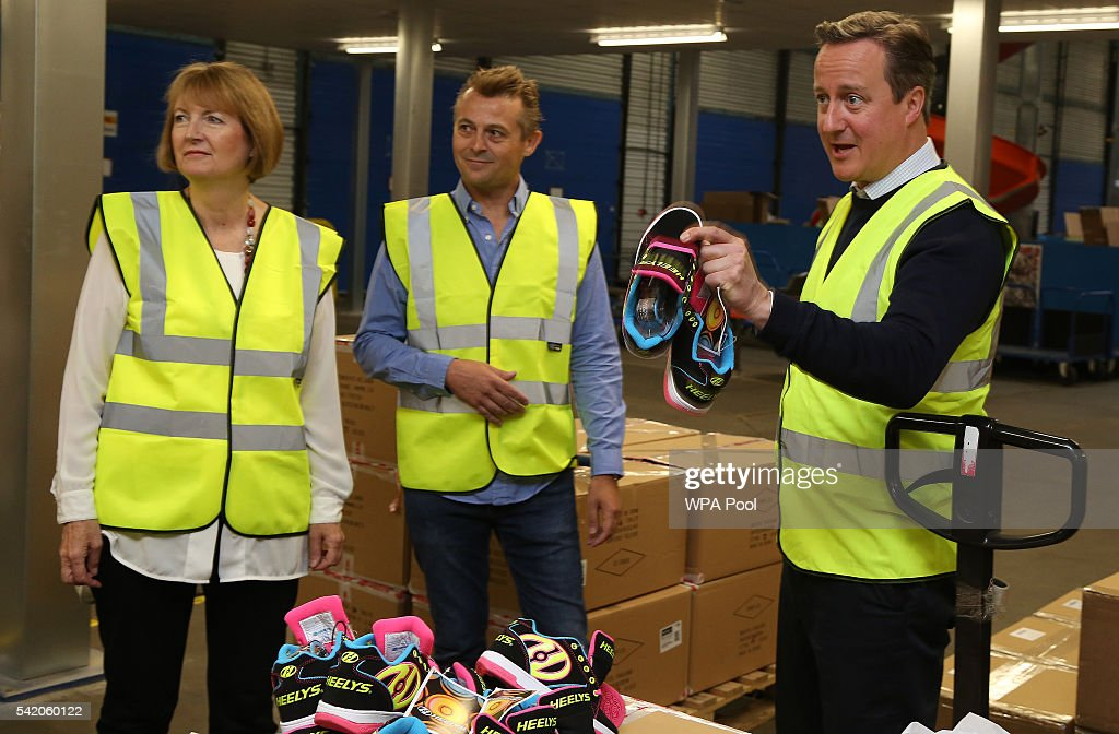 British Prime Minister David Cameron (C) and British Home Secretary Harriet Harman (L) tour sports equipment distributor Shiner Ltd.'s offices on June 22, 2016 in Bristol, United Kingdom. The final day of campaigning continues across the UK as the country prepares to go to the polls on June 23rd to decide whether Britain should remain or leave the European Union.
