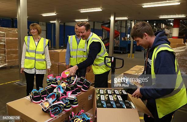 British Prime Minister David Cameron and British Home Secretary Harriet Harman tour sports equipment distributor Shiner Ltd's offices on June 22 2016...