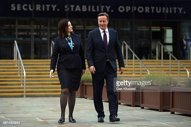 British Prime Minister David Cameron and Caroline Ansell MP for Eastbourne and Willingdon walk through Manchester Central on the third day of the...