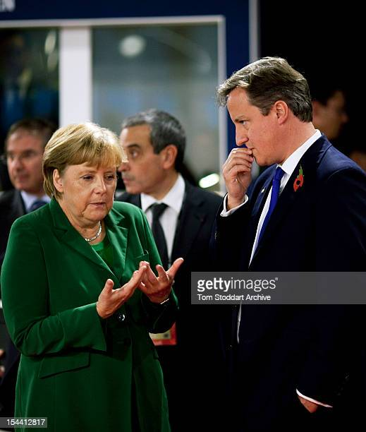 British Prime Minister David Cameron and Chancellor Angela Merkel of Germany chat during the G20 Summit in Cannes France 3rd January 2011