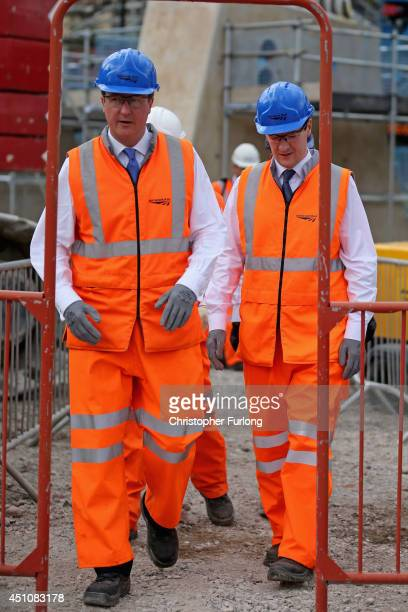 British Prime Minister David Cameron and Chancellor George Osborne tour building works at Manchester's Victoria Railway Station which is being...