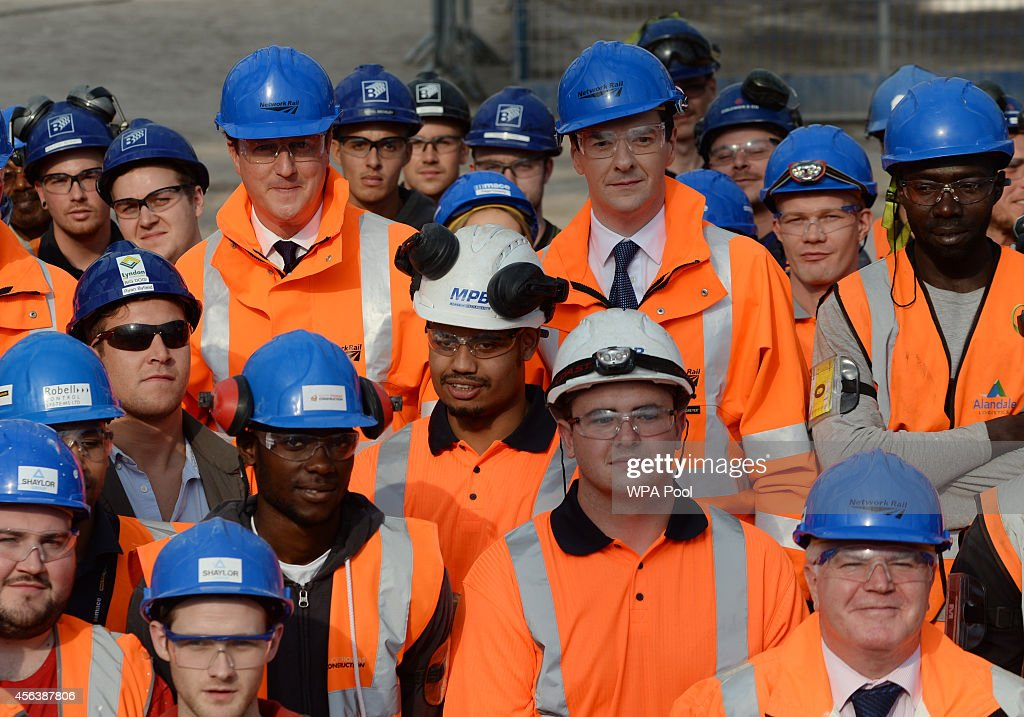 British Prime Minister David Cameron and Chancellor George Osborne meet apprentices and managers at the redevelopment of New Street station on September 30, 2014 in Birmingham, England. The £750 million project, which will include a shopping centre, will be fully open by September 2015.