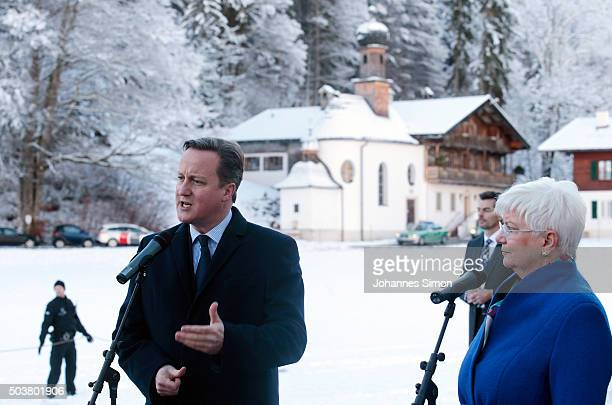 British Prime Minister David Cameron and CSU faction leader Gerda Hasselfeldt address the media after a meeting with German chancellor Angela Merkel...