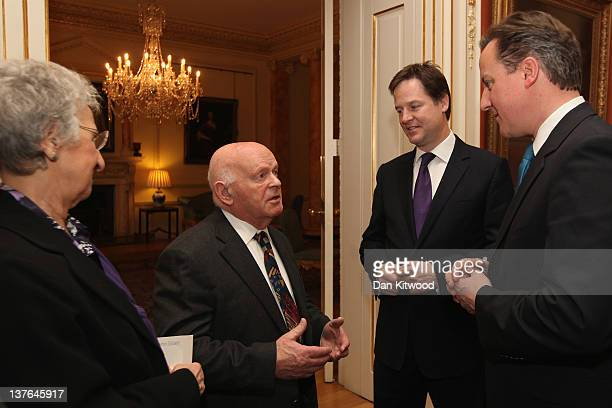 British Prime Minister David Cameron and Deputy Prime Minister Nick Clegg greet representatives from the Holocaust Educational Trust including...