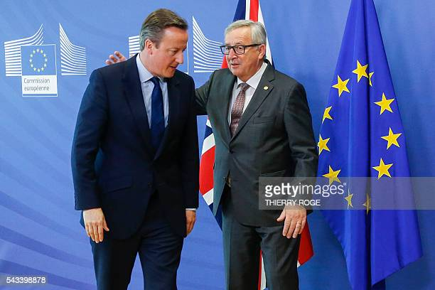 TOPSHOT British Prime Minister David Cameron and European Commission President JeanClaude Juncker speak before a bilateral meeting on the first day...