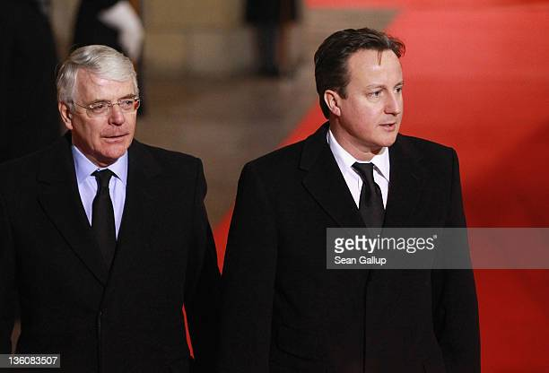 British Prime Minister David Cameron and former British Prime Minister John Major arrive for the state funeral of former Czech President Vaclav Havel...