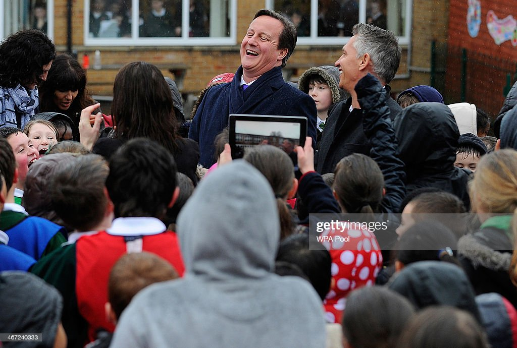 British Prime Minister David Cameron and former professional footballer  Gary Lineker speak to pupils of St