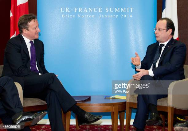 British Prime Minister David Cameron and France's President Francois Hollande attend a meeting during a one day summit at RAF Brize Norton on January...