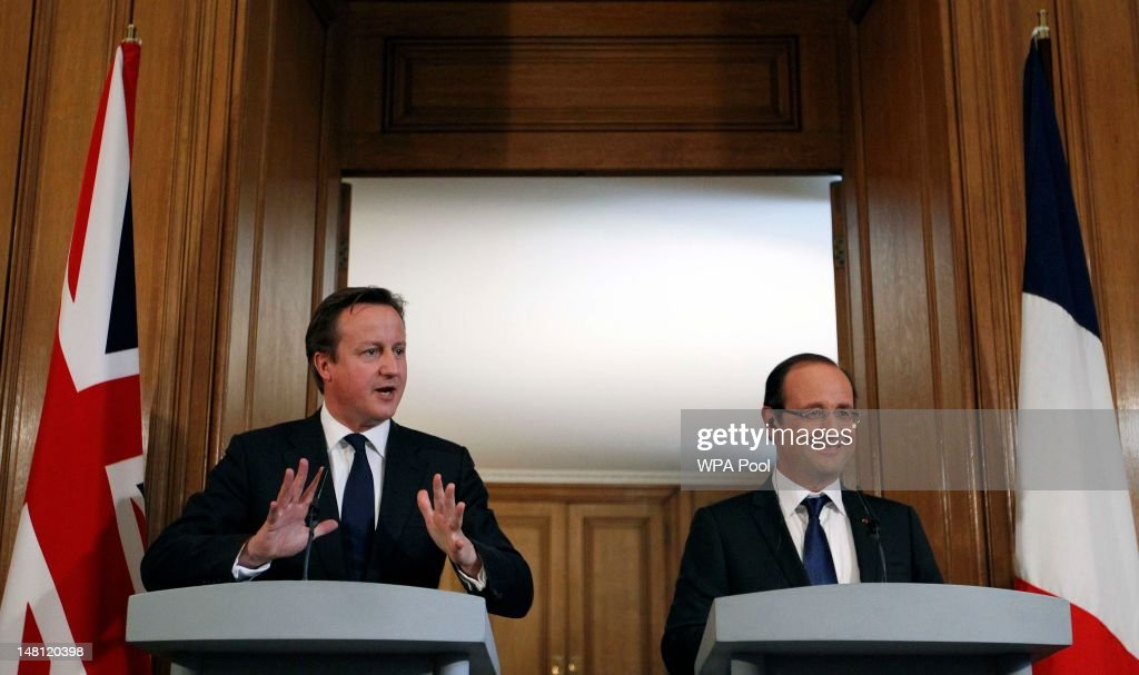 British Prime Minister David Cameron (L) and French President Francois Hollande speak in Number 10 Downing Street on July 10, 2012 in London, England. This is the French President's first official visit to the United Kingdom since taking office, during which he will attend meetings with British Prime Minister David Cameron and Queen Elizabeth II.