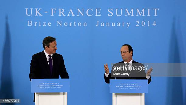 British Prime Minister David Cameron and French President Francois Hollande take part in a press conference during the joint summit at RAF Brize...