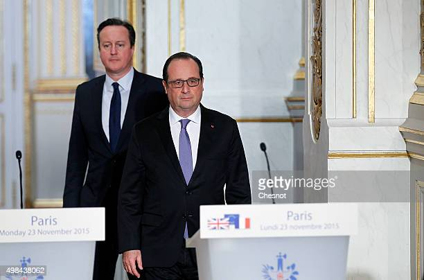 British Prime Minister David Cameron and French President Francois Hollande arrive to attend a press conference at the Elysee Palace on November 23...