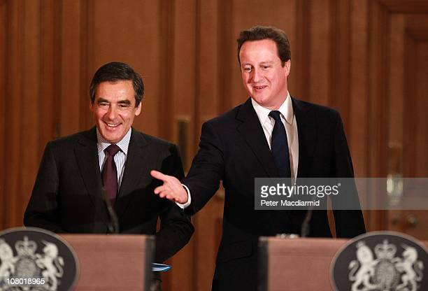 British Prime Minister David Cameron and French Prime Minister Francois Fillon arrive to attend a press conference at 10 Downing Street on January 13...