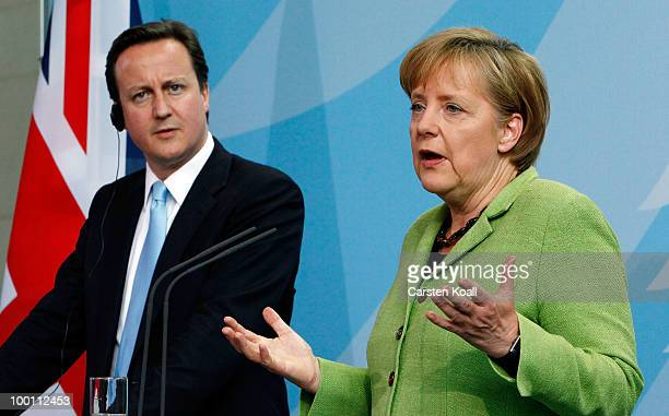British Prime Minister David Cameron and German Chancellor Angela Merkel attend a press conference at the Chancellery on May 21 2010 in Berlin...
