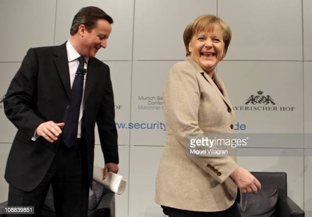 British Prime Minister David Cameron and German Chancellor Angela Merkel share a laugh during the second day of the 47th Munich Security Conference...