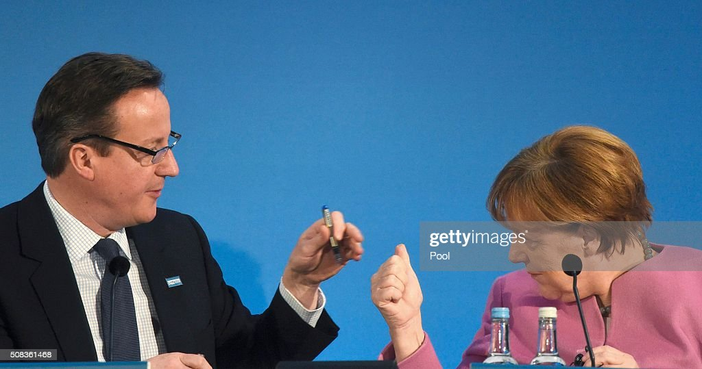 British Prime Minister David Cameron (L) and German Chancellor Angela Merkel attend a donor conference entitled 'Supporting Syria & The Region' at the QEII centre in central London on February 4, 2016. World leaders gather in London on Thursday to try to raise $9 billion (8.3 billion euros) for the millions of Syrians hit by the country's civil war and a refugee crisis spanning Europe and the Middle East. MELVILLE