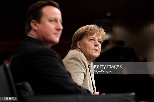 British Prime Minister David Cameron and German Chancellor Angela Merkel attend the second day of the 47th Munich Security Conference at Hotel...
