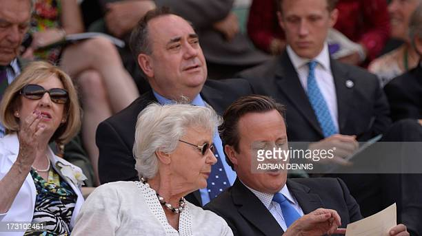 British Prime Minister David Cameron and his mother Mary sit in the royal box in front of Scotland's First Minister Alex Salmond and his wife Moira...