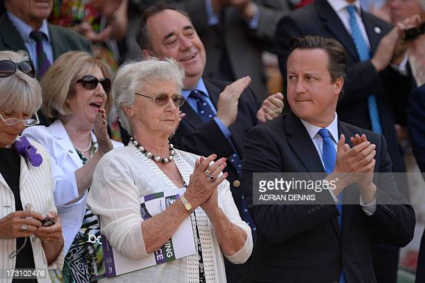 British Prime Minister David Cameron and his mother Mary stand in the royal box in front of Scotland's First Minister Alex Salmond and his wife Moira...