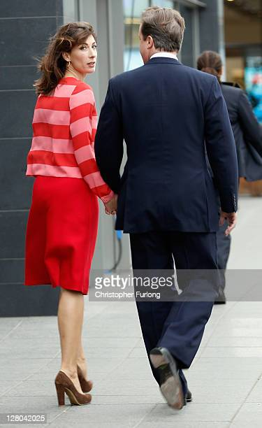 British Prime Minister David Cameron and his wife Samantha arrive at Manchester Central for his speech at the annual Conservative Party Conference at...