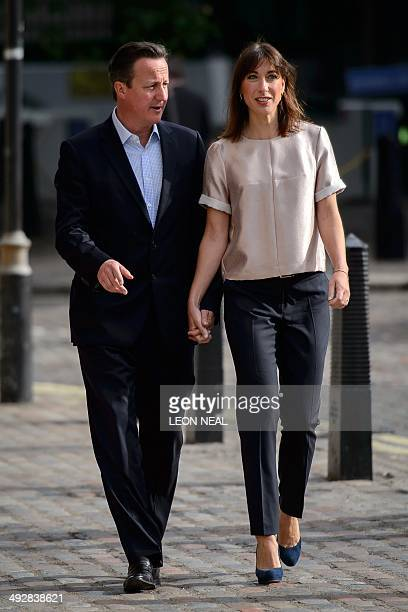 British Prime Minister David Cameron and his wife Samantha arrive at Westminster Methodist Hall in central London before voting in the local and...