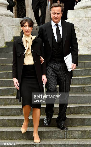 British Prime Minister David Cameron and his wife Samantha Cameron depart the funeral of Baroness Margaret Thatcher on April 17 2013 in London...