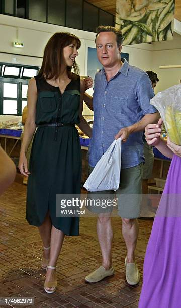 British Prime Minister David Cameron and his wife Samantha Cameron leave the market of Aljezur after buying squid on July 26 in Aljezur Portugal The...