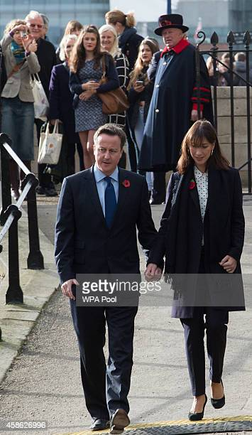 British Prime Minister David Cameron and his wife Samantha Cameron arrive at the Tower of London where they will each lay a poppy at the art...