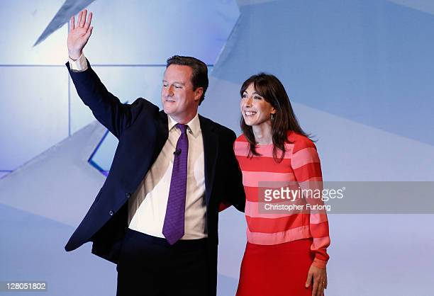 British Prime Minister David Cameron and his wife Samantha react after delivering his keynote speech to delegates at the annual Conservative Party...