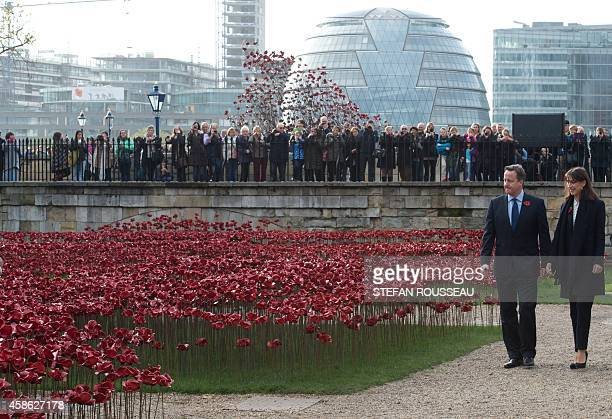 """British Prime Minister David Cameron and his wife Samantha visit """"Blood Swept Lands and Seas of Red"""" installation by ceramic artist Paul Cummins and..."""