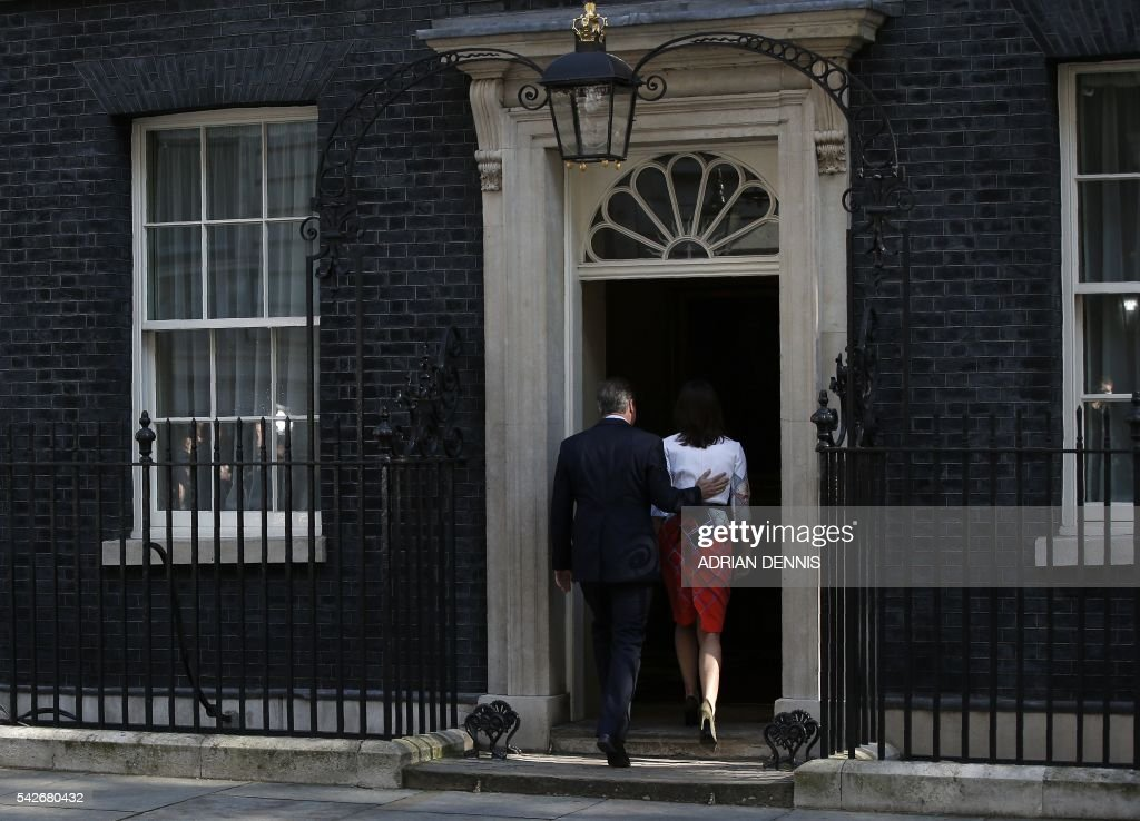 TOPSHOT - British Prime Minister David Cameron (L) and his wife Samantha walk back into 10 Downing street after he spoke to the press in central London on June 24, 2016. Britain has voted to break out of the European Union, striking a thunderous blow against the bloc and spreading panic through world markets Friday as sterling collapsed to a 31-year low. /