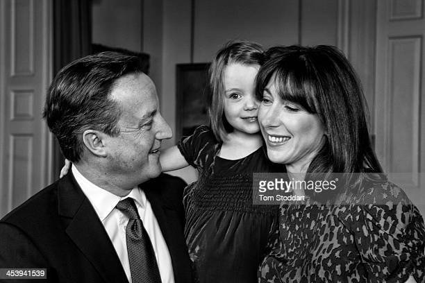 British Prime Minister David Cameron and his wife Samantha photographed with daughter Florence at 10 Downing Street for their 2013 Christmas card on...
