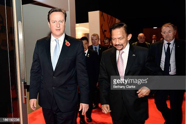 British Prime Minister David Cameron and HM Sultan Hassanal Bolkiah of Brunei Darussalam leave the main hall for lunch during the Leaders Panel at...