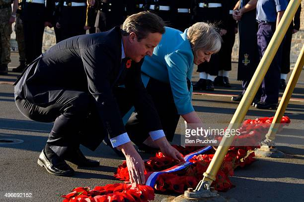 British Prime Minister David Cameron and Home Secretary Theresa May lay a wreath during a remembrance service on HMS Bulwark during the Valletta...