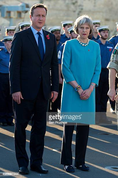 British Prime Minister David Cameron and Home Secretary Theresa May attend a remembrance service on HMS Bulwark during the Valletta Summit on...