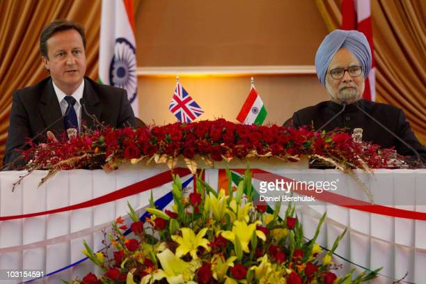 British Prime Minister David Cameron and Indian Prime Minister Manmohan Singh address members of the media during a joint press conference at...