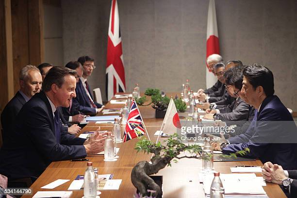 British Prime Minister David Cameron and Japanese Prime Minister Shinzo Abe speak during a bilateral meeting on May 24 2016 in Shima Japan The G7...
