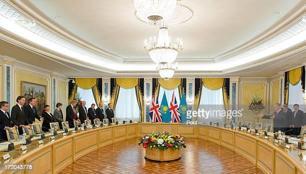 British Prime Minister David Cameron and Kazakhstan President Nursultan Nazarbayev take their seats for trade talks at the Presidential Palace on...