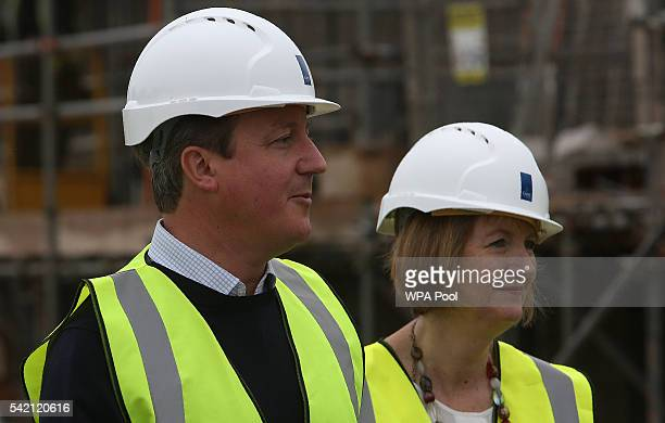 British Prime Minister David Cameron and Labour MP Harriet Harman tour a Crest Nicholson residential house construction site on June 22 2016 in...