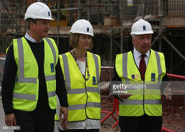 British Prime Minister David Cameron and Labour MP Harriet Harman listen to Crest Nicholson CEO Stephen Stone as they tour a Crest Nicholson...