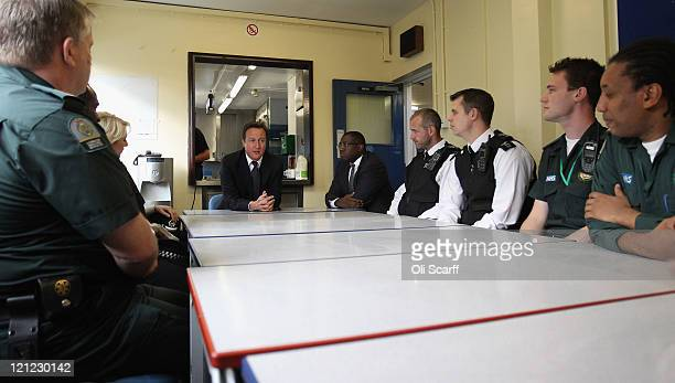 British Prime Minister David Cameron and local MP David Lammy visit the Tottenham fire station to hold a meeting with representatives from the...